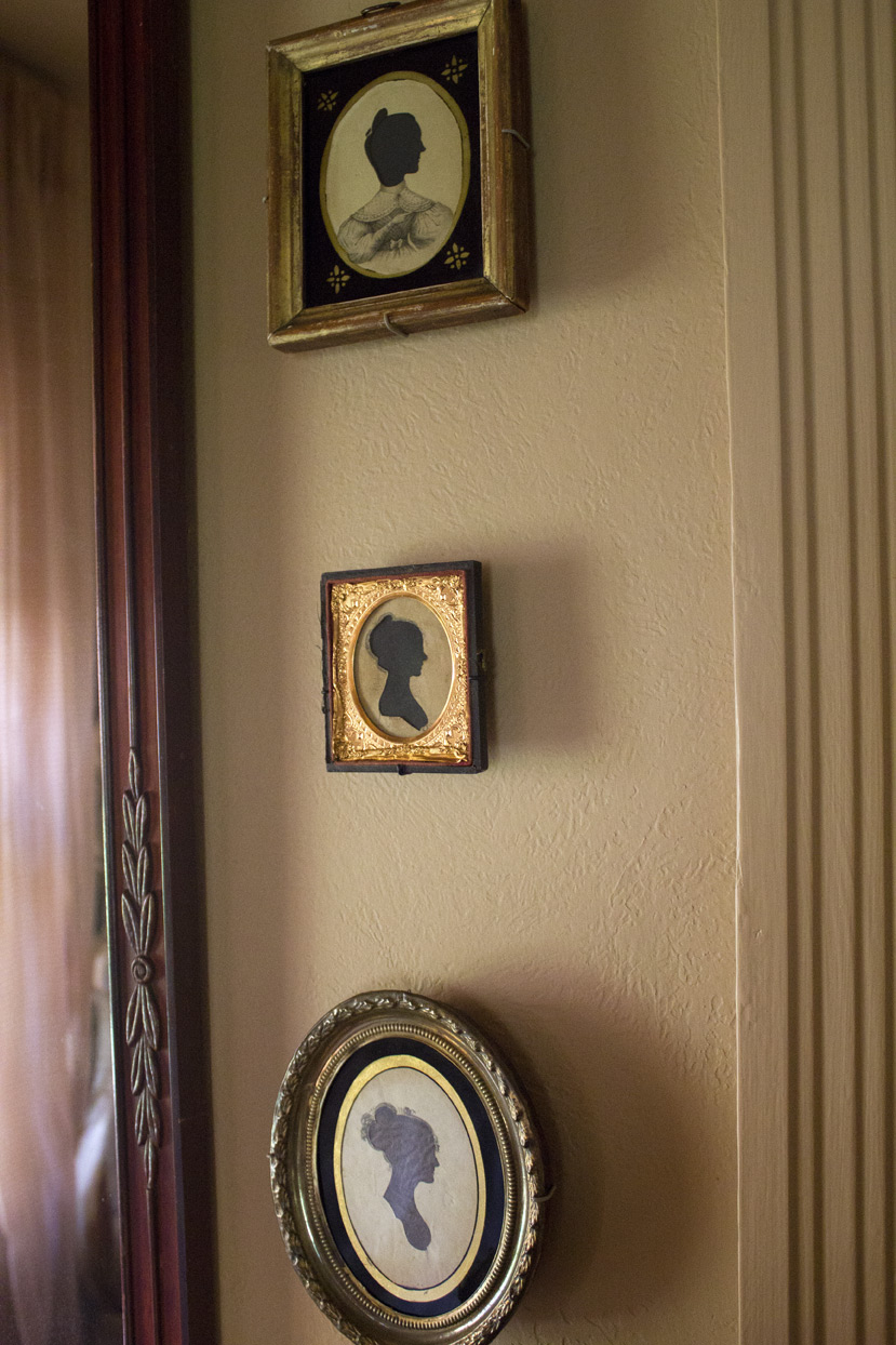 (above) top silhouette: American, circa 1830--The head is a hollow-cut from one piece of wove paper. The lithographed body is a second piece of paper that has been lightly pasted onto the black silhouette paper. A reverse painted glass tops the image layers. middle silhouette: American, circa early 1800s, by Joseph Wood, the sitter is Miss Sally Worster. bottom silhouette: American, New England, circa early 1800s, artist unknown.