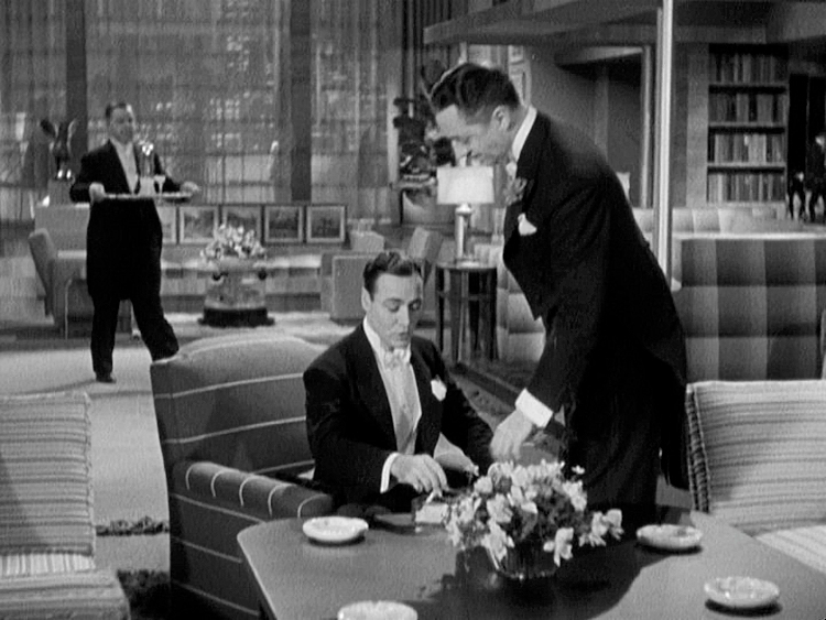(above) Dal Dalzell must be an excellent lawyer, because his Park Avenue apartment is luxuriously appointed with beautiful Art Deco furnishings and details, and his servant is constantly entering the room with a tray full of drinks.