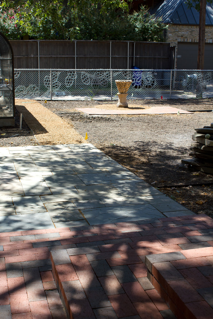 (above looking towards the alley) To the right of the path and stone pad is where the sun garden will be installed. To the left will be another shade garden.