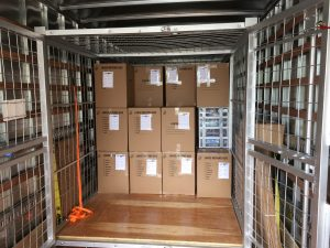 cardboard boxes in truck are packed with assistance from packing services Dallas
