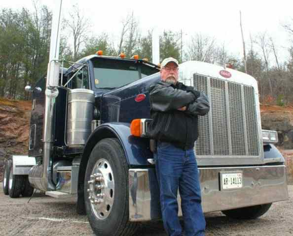 A Guide to Kicking Off Your Trucking Career   Making That Big Decision Experienced Veteran Truck Driver Smart Trucking Leaning on 379 Peterbilt 40  year Trucking Career