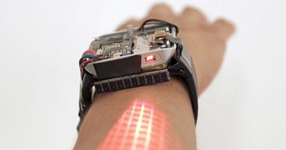 Smartwatch concept projects touch display on user's arm ...