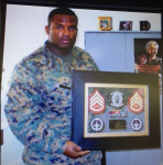 SSgt Rosario with the VMGR 314 Plaque