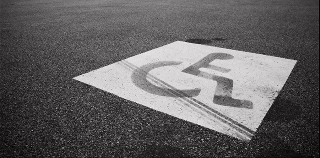 disability-icon-user-in-wheelchair-on-pavement