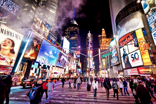 image-time-square-nyc-at night with bright lights and diverse crowds of people