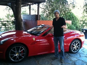 ashton kutcher beside his ferrari california