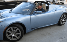 matt Damon riding his Tesla Roadster