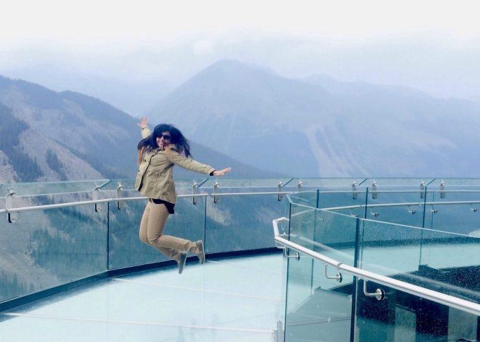 Woman jumping on the Jasper Skywalk