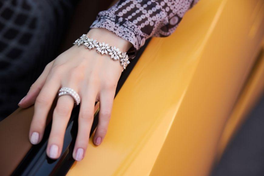diamond ring and bracelet on yellow car.