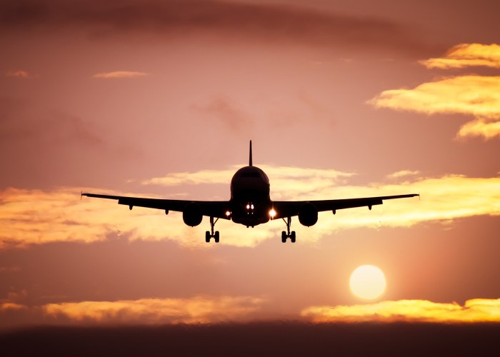 airplane sky sunset