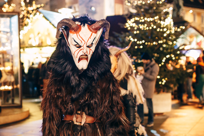 Krampus masked people in graz at a krampus festival
