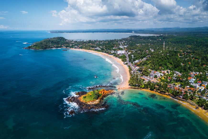 aerial panorama tropical beach Mirissa Sri Lanka.