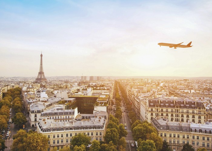 airplane flying over eiffel tower in paris france
