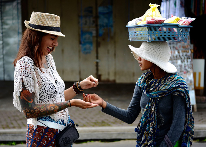 buying fruit in bali women-only travel