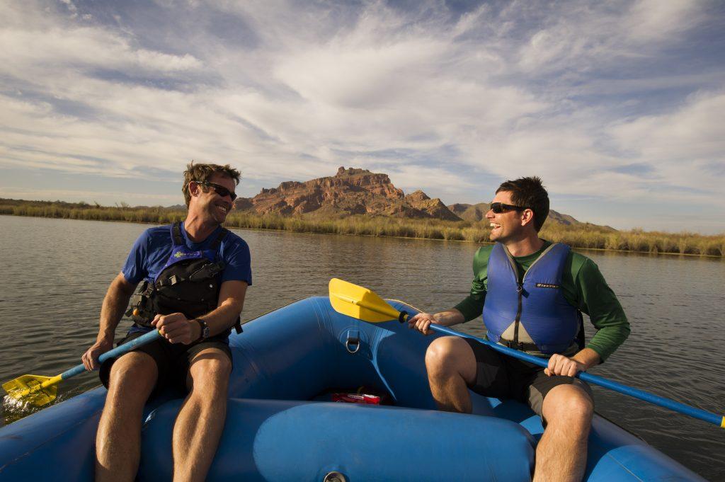 two men white water rafting