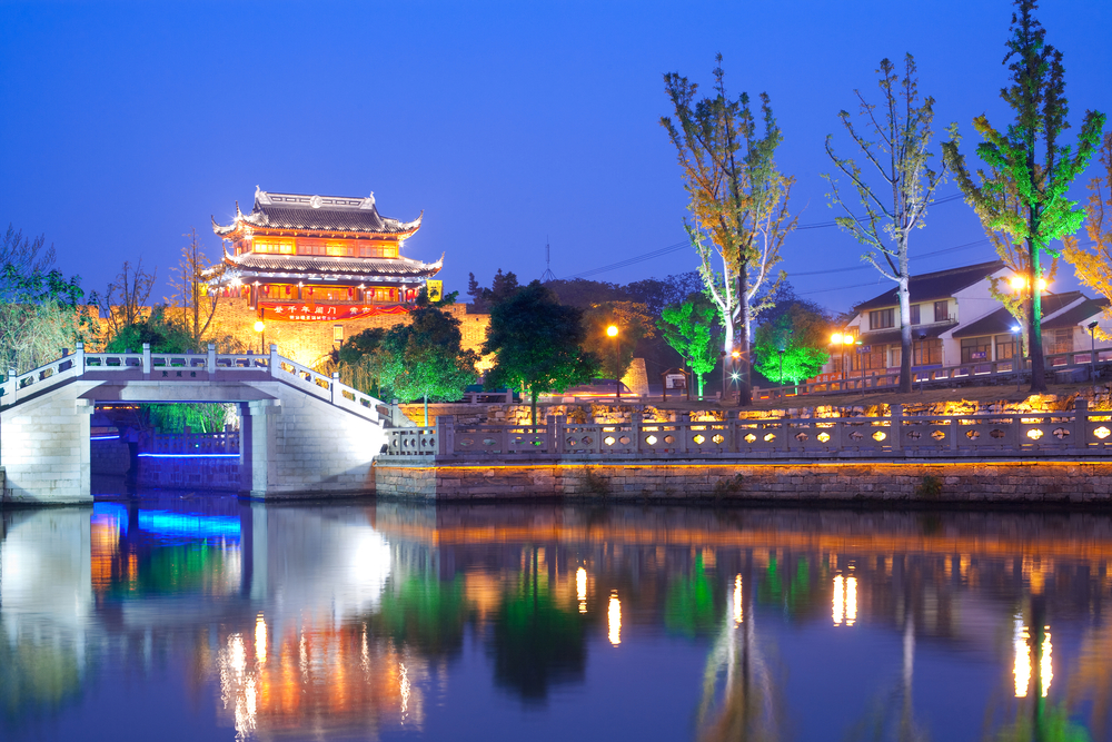 bright lights over suzhou canal in china at night.