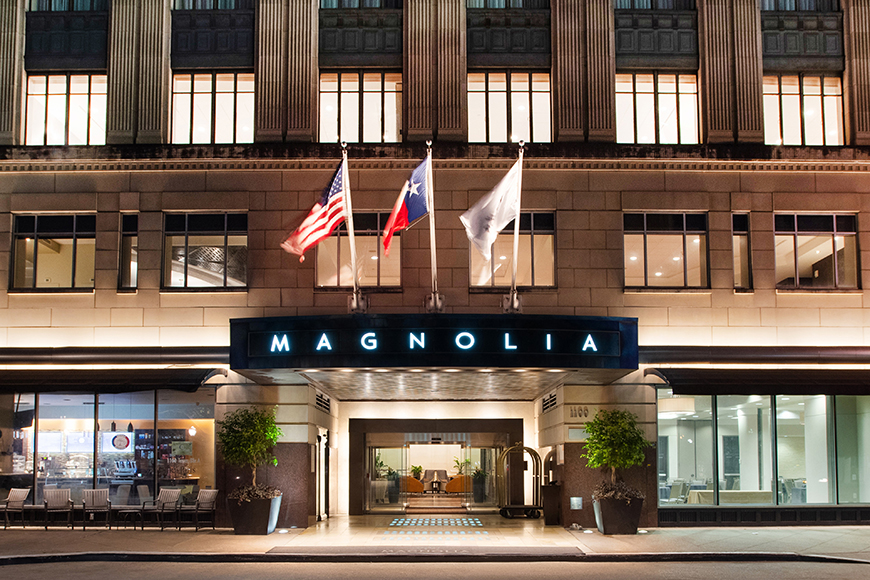 magnolia hotel houston exterior at night.
