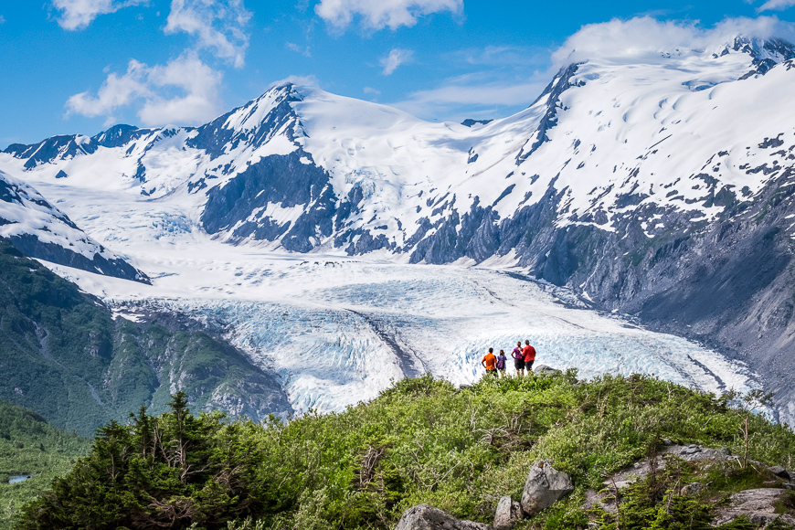 Hikers enjoy the view of Portage Glacier from Portage Pass Trail outside Anchorage, Alaska.
