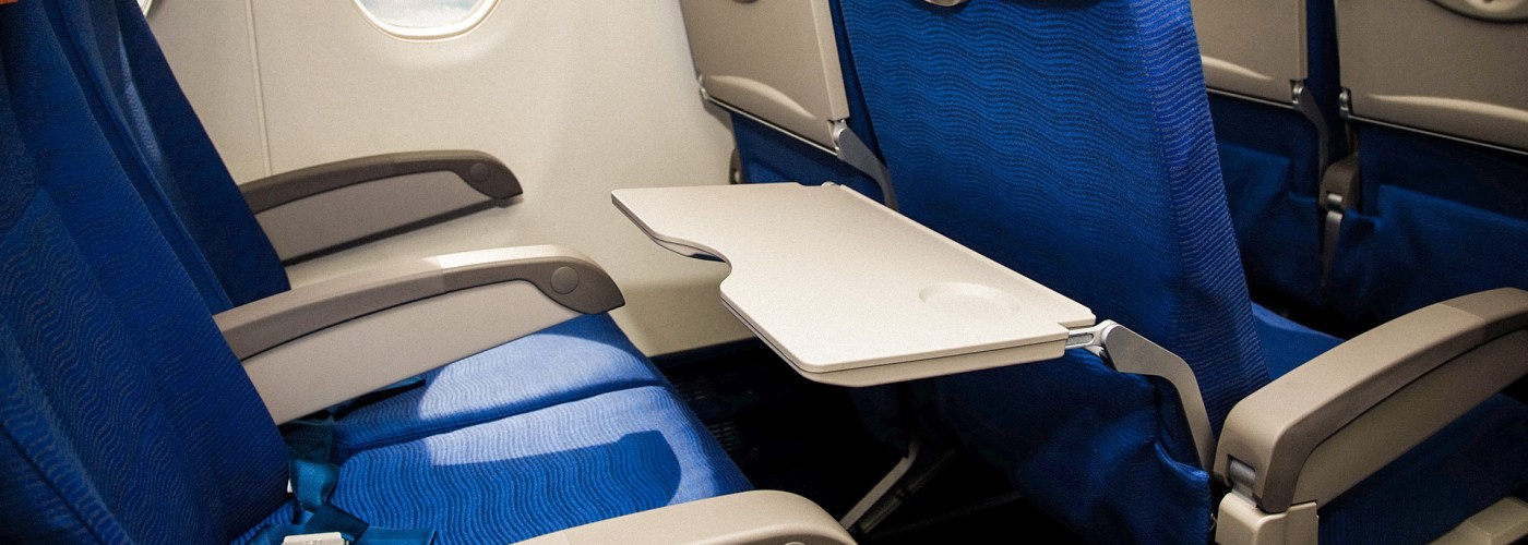 airplane seats empty tray table down