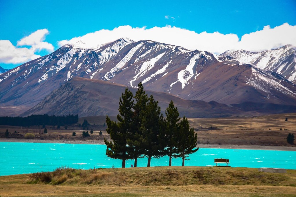 new zealand lake with mountain in background