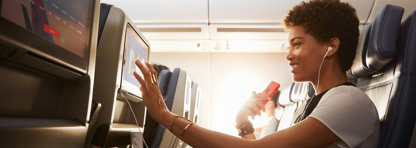 woman uses Delta's in-flight entertainment