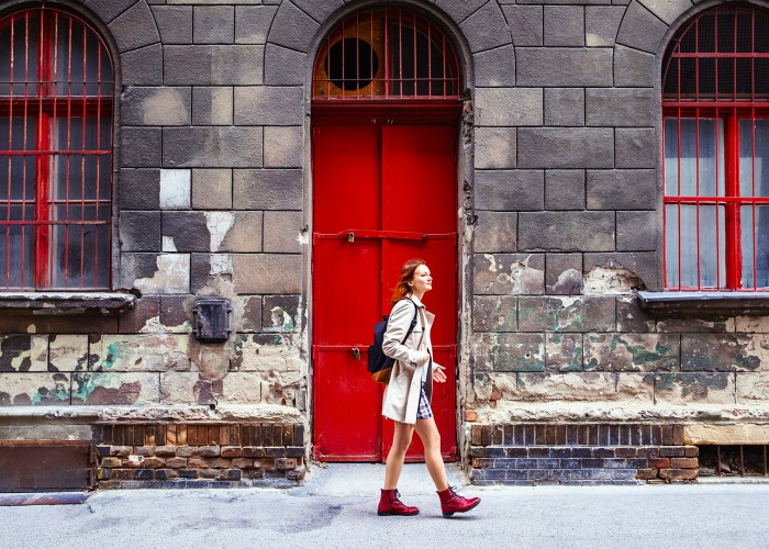 tylish woman on the Background of European City Street and one of the historical architectural buildings of Budapest, Hungary