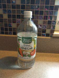 Plain white vinegar (notice I have Aldi brand!)