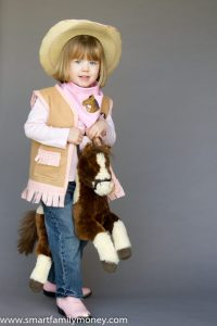 My adorable cowgirl with her homemade vest.
