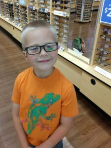 Happy boy with his favorite color on his glasses!