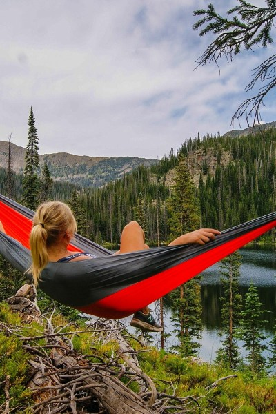 Women enjoying a cheaper alternative to eno hammock by a mountain stream.