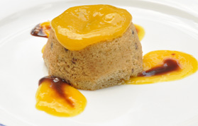 Sweet sorghum muffin served with mango and chocolate sauce