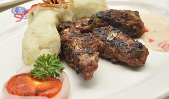 Sorghum and millet kebabs served with sweet mashed potatoes