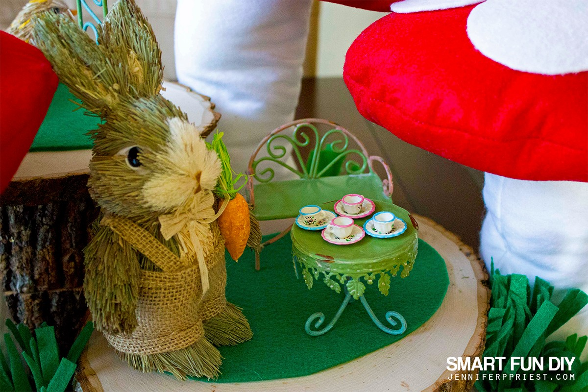 Make a DIY fairy garden under a forest of GIANT mushrooms, ala Alice in Wonderland! This project is easy to make AND features lots of upcycled and recycled  supplies. Earth love ;)