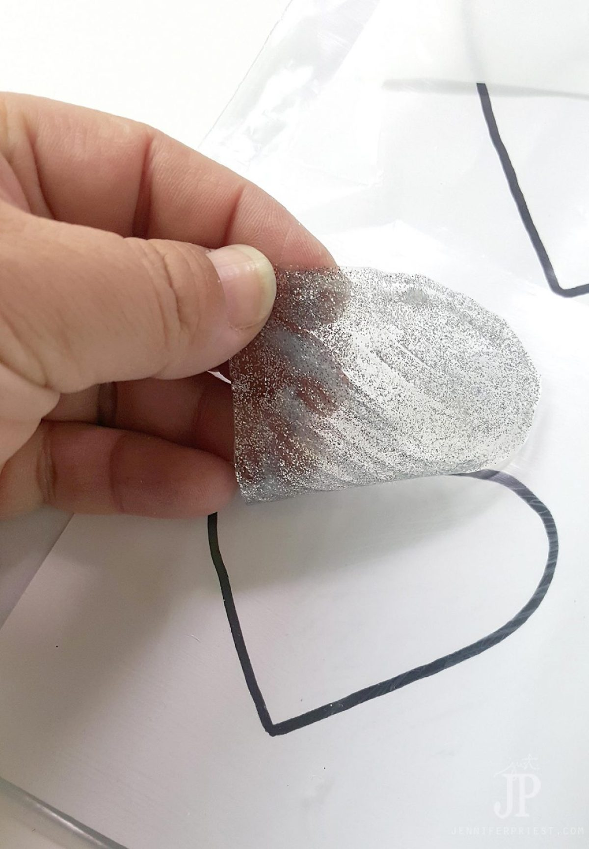 Smart tip: use freezer bags as a nonstick craft sheet to make DIY puffy paint window clings and doilies - this post shows how to make BOTH!