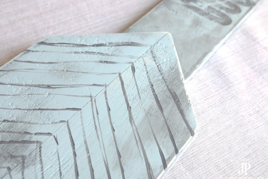 Detail-end-of-handpainted-arrow-sign-PLAID-Design-Master-spray-paint-Jennifer-Priest