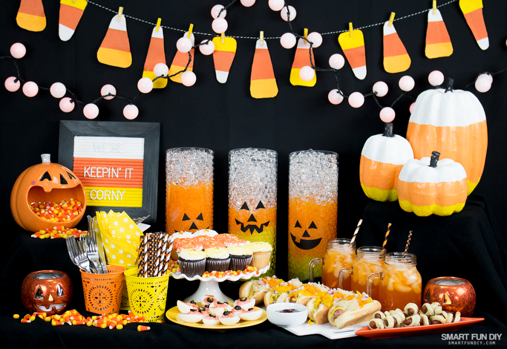 Throw a CANDY CORN Halloween party this year! This blog has cute ideas for decor, like these candy corn vases with water beads from GEMNIQUE.