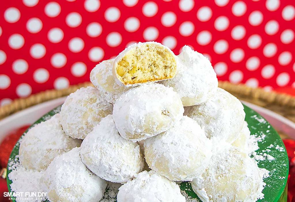 The BEST Christmas Cookie recipe that everyone will love! Easy cookie recipe - learn why they are called both Mexican Wedding Cakes or Russian Tea Cakes #ChristmasCookies #SmartFunDIY #RussianTeaCakes #CookieRecipe #MexicanWeddingCakes #mexicancookies