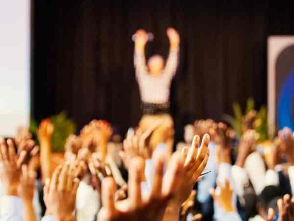 Raised hands summit event public speaker marketing