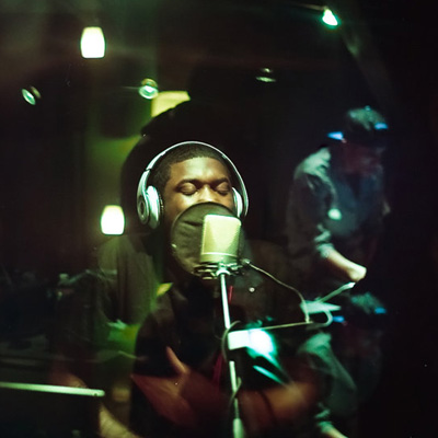 rapper recording in booth
