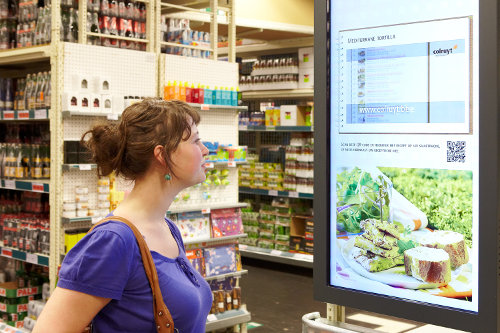 Retail shopper viewing digital signage