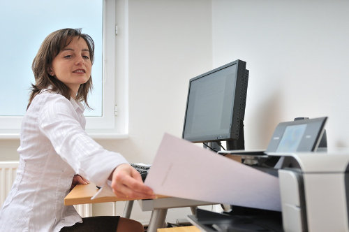 Businesswoman printing documents