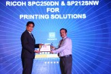 MR. SANJIB MOHAPATRA IS GIVING AWAY THE AWARD OF BEST SME PRINTING SOLUTIONS TO RICOH SPC 250DN AND SP212SNW