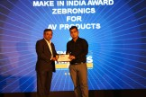 MR. VISWANATH RAMASWAMY, VP, POWER SYSTEMS, IBM INDIA AND SOUTH ASIA GIVING AWARD OF MAKE IN INDIA AV PRODUCTS TO SEBRONICS