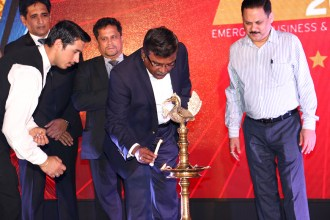 Viswanath Ramaswamy of IBM lighting the lamp