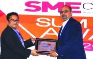 SANJAY MOHAPATRA OF SME CHANNELS GIVING AWAY SUPER50 AWARD TO RUBIK INFOTECH PVT. LTD