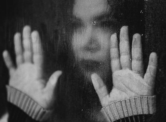 abuse victim in window