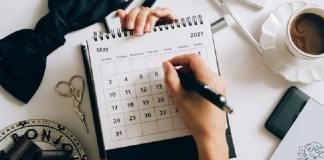 Hand filling in calendar