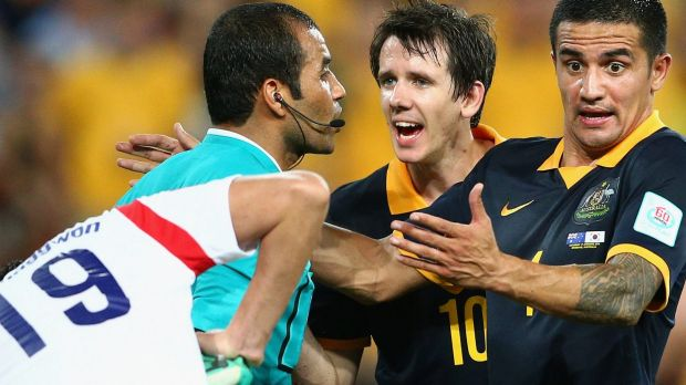 Tim Cahill argues with the referee.