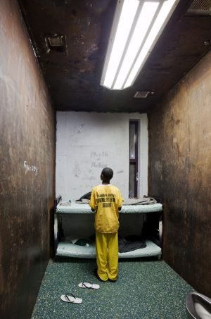 A 12-year-old juvenile in his windowless cell at Harrison County Juvenile Detention Center in Biloxi, Mississippi. The prison is run by Mississippi Security Police, a private service.