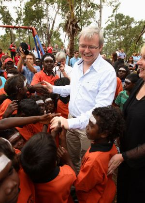 """Kevin Rudd, pictured at a school in the East Arnhem Land community of Yirrkala in 2008, has warned of new """"stolen generation""""."""